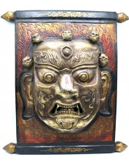 Pannello in legno con raffigurazione di Mahakala in bronzo